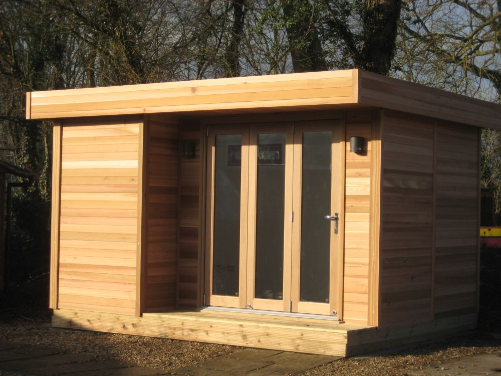 12ft wide x 10ft deep cedar clad garden room with trifold dg door home office in the