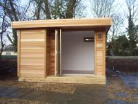 12 wide x 10 deep cedar clad Garden Room with trifold door.