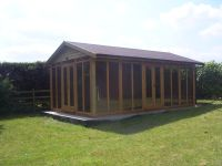 20 x 12 Office with sun reflective glass. Contemporary design with a pitched roof.