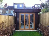 2.4m x 5m wide a mono pitched roof. Including a trifold door.