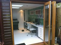 Internal view of a 2.4m x 5m Contemporary office, with furniture. Customer decorated after we had installed.