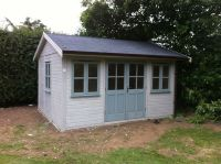 4.4m x 3.6m wide Traditional Office with doors and windows painted in Silver Grey Blue, and the cladding in Warm Grey