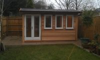 4m x 3m Garden Office clad in Cedar, with a fully painted finish to the doors and windows. This building is 2.5m high.