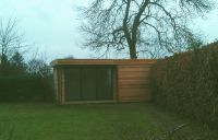6m x 3.6m Cedar Garden Building with dark grey trifold doors.