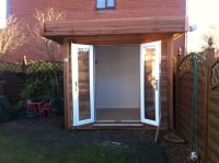 Lovely little 2.4m x 2.4m Cedar Garden Office. Doors and windows in light oak PVC. Features white inside lining.