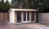 4.2m x 3m Office with a cedar shingle roof and contemporary double doors. The sidelights are 900mm full glass panels.