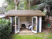 Garden Office with Cedar Shingles and a log burner