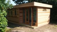 6.2m x 3.6m Cedar Clad Contemporary Office with a recessed door.