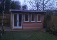 12 x 8 Cedar Garden Room with painted doors and windows
