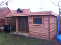 5m x 3m Cedar Garden Room with Bi-fold door in recess area.