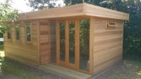 Cedar Clad garden office with bi-fold door in recess