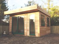 3.8m x 3.6m Office with Green Doors & Cedar Cladding