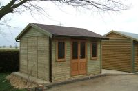 12 x 12 Garden Office with contemporary windows, and half glazed contemporary double doors.