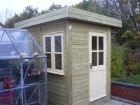 2.4m wide x 1.8m deep Garden Office with cream painted doors and windows and a mono pitched roof