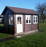 12ft x 8ft shiplap clad with Protek finish to exterior and contrast colour to all joinery Red/Brown Felt Tile Roof